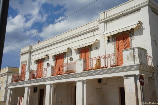 Leuca house with orange blinds