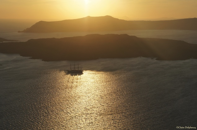 Sail boat sunset Santorini