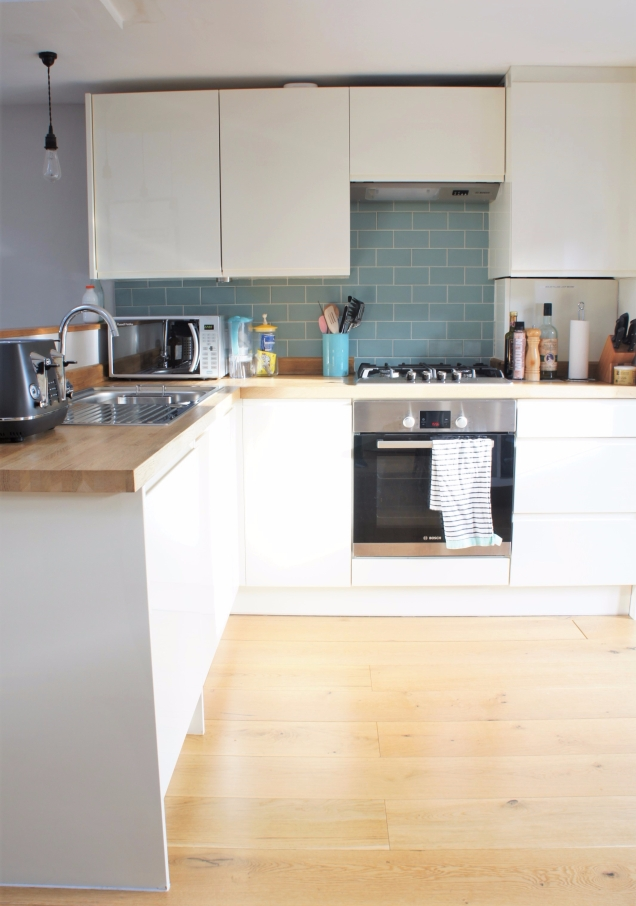 White kitchen and wood counter top