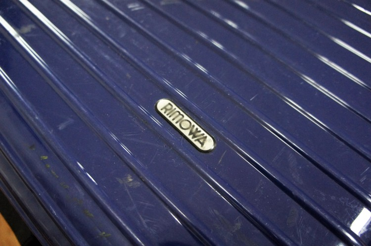 Rimowa logo on suitcase