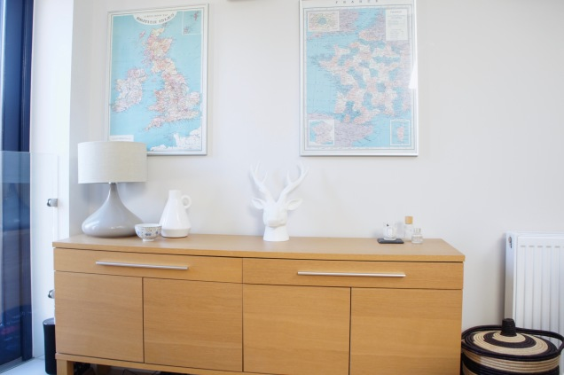 Ikea sideboard and vintage maps in living-room