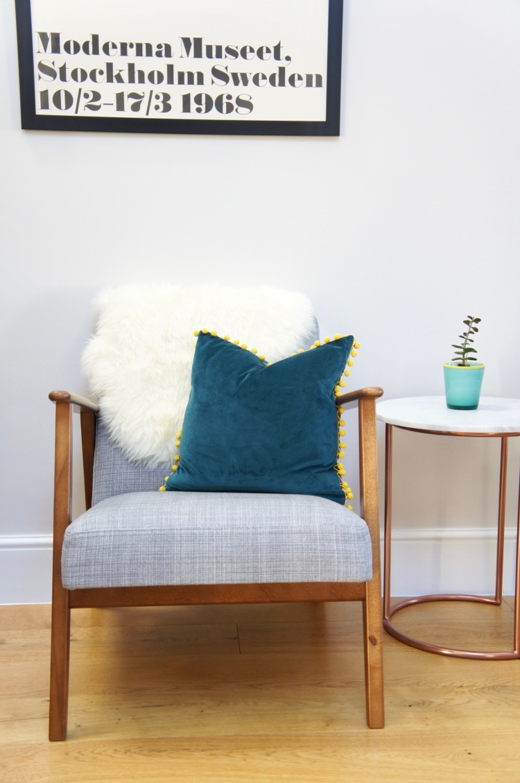 TK Maxx teal velvet cushion - 5 tips to easily save money when decorating your home
