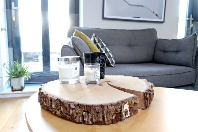 Ikea coffee table, Jo Malone Diptyque candles, wood slice