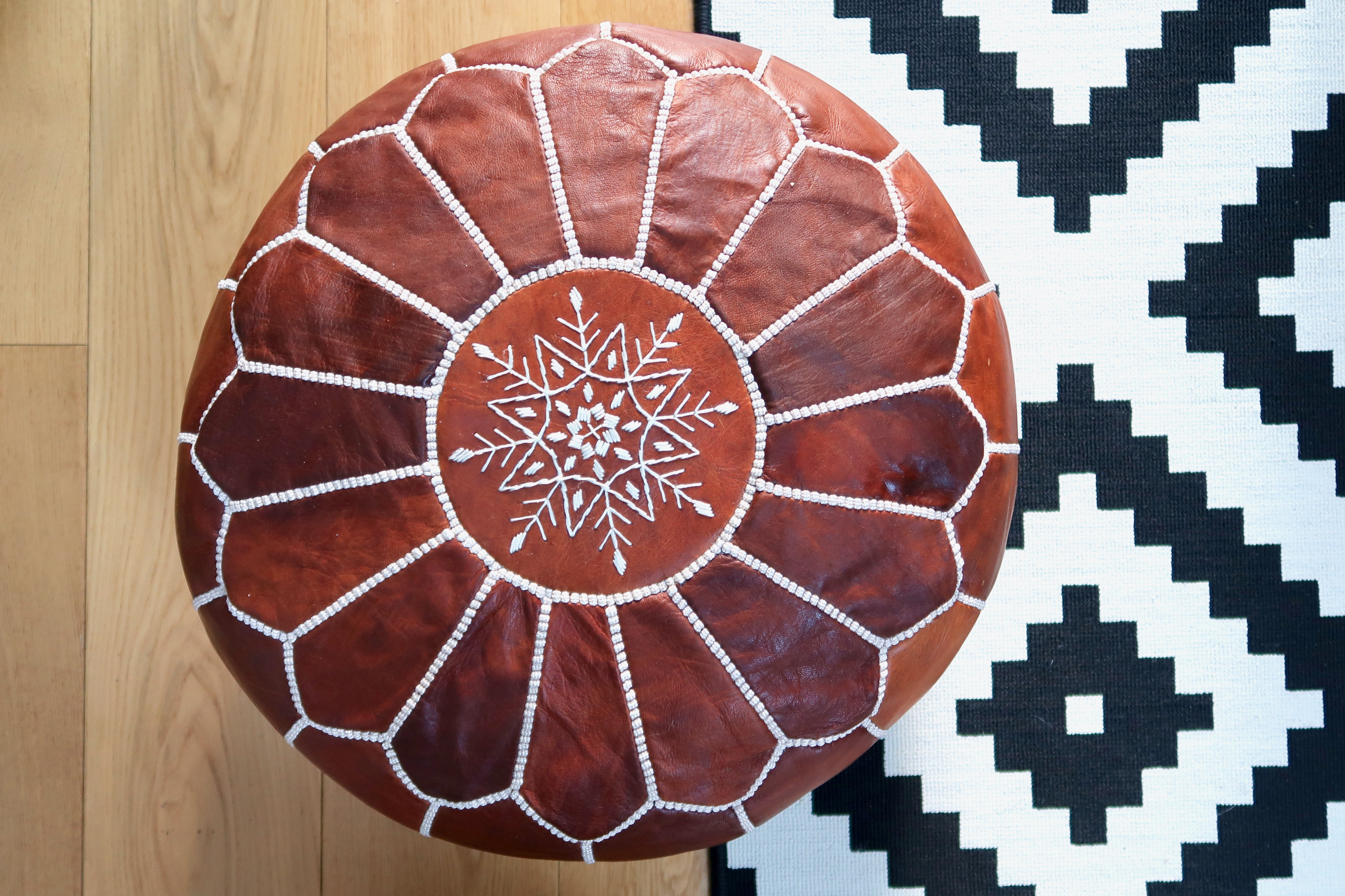 Tan Moroccan pouffe, Ikea rug